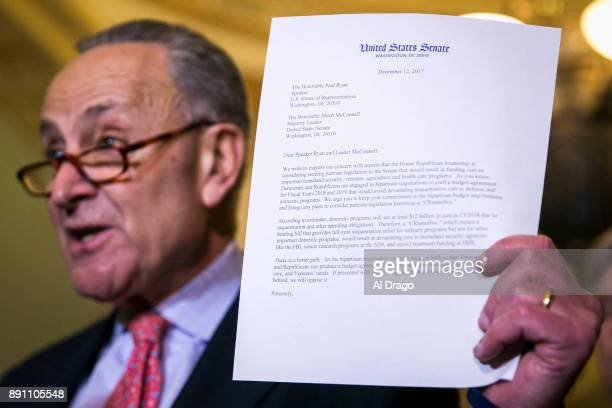 Senate Minority Leader Charles Schumer holds a letter written to Senate Majority Leader Mitch McConnell and House Speaker Paul Ryan expressing...