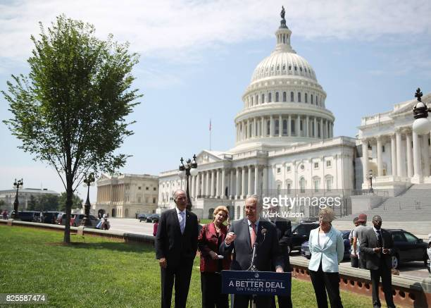 Senate Minority Leader Charles Schumer is joined by fellow Democrats while speaking during an event to unveil 'A Better Deal On Trade and Jobs' in...