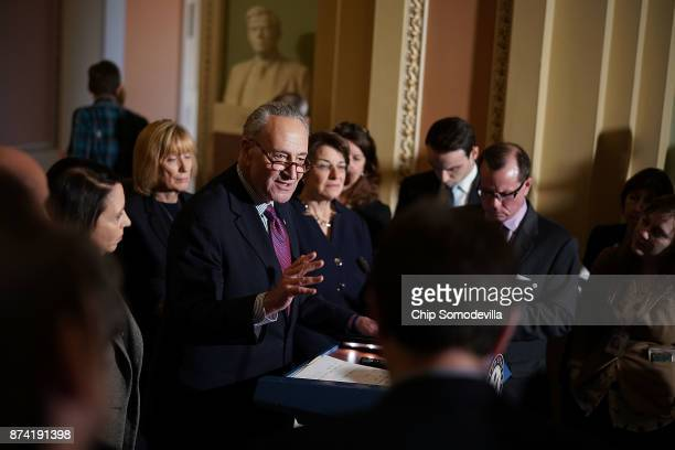 Senate Minority Leader Charles Schumer is joined by Sen Maria Cantwell Sen Maggie Hassan and Sen Amy Klobuchar while talking to reporters following...