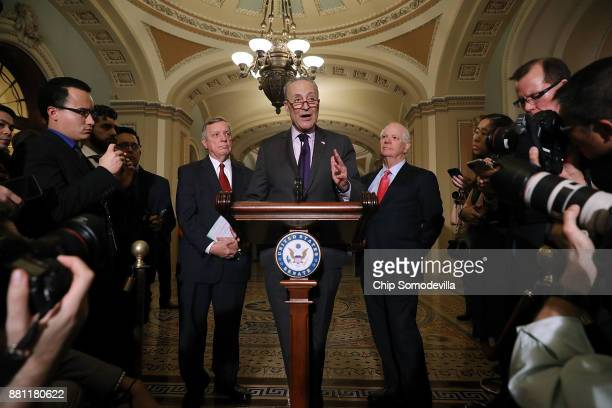 Senate Minority Leader Charles Schumer is joined by Senate Minority Whip Dick Durbin and Sen Ben Cardin while talking to reporters following the...