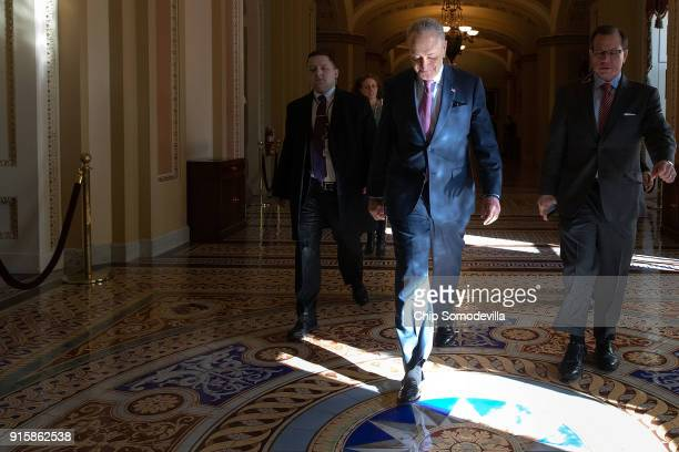 Senate Minority Leader Charles Schumer returns to his office following a Senate Democratic caucus luncheon at the US Capitol February 8 2018 in...