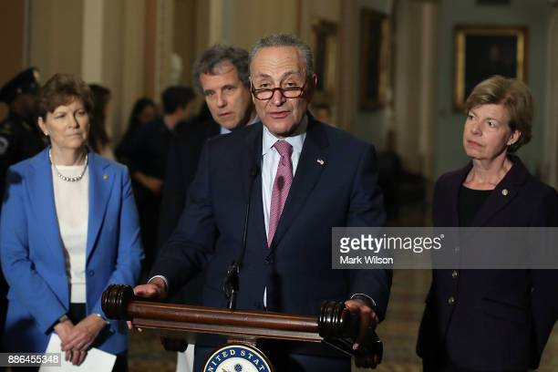 Senate Minority Leader Charles Schumer speaks to reporters about the tax reform bill the Senate passed last week and the possibility of a Government...