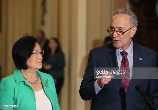 Senate Minority Leader Charles Schumer speaks to the media while flanked by Sen Mazie Hirono after attending the Senate Democrats policy luncheon on...