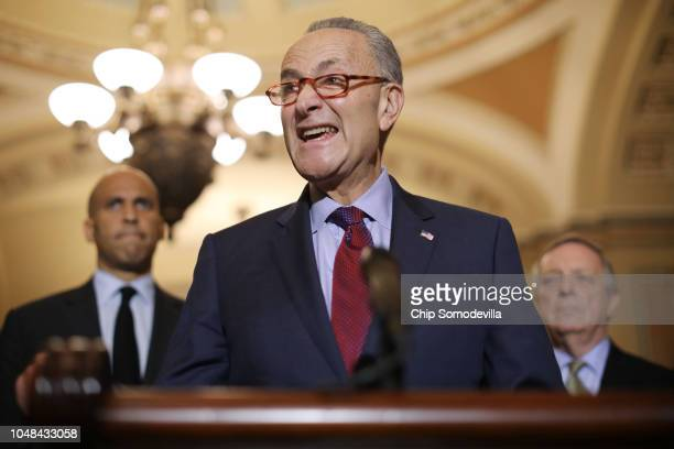 Senate Minority Leader Charles Schumer talks to reporters with Sen Cory Booker and Sen Richard Durbin following the weekly Senate Democratic policy...