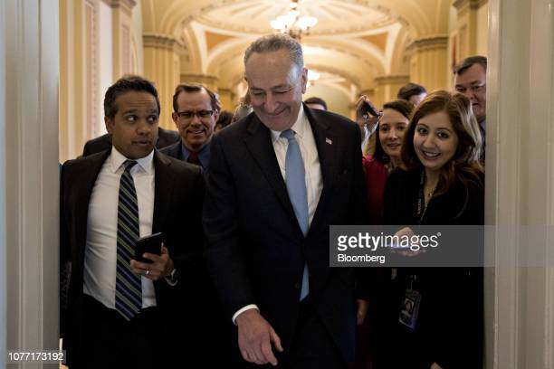 Senate Minority Leader Chuck Schumer a Democrat from New York center walks through the US Capitol after returning from a meeting at the White House...