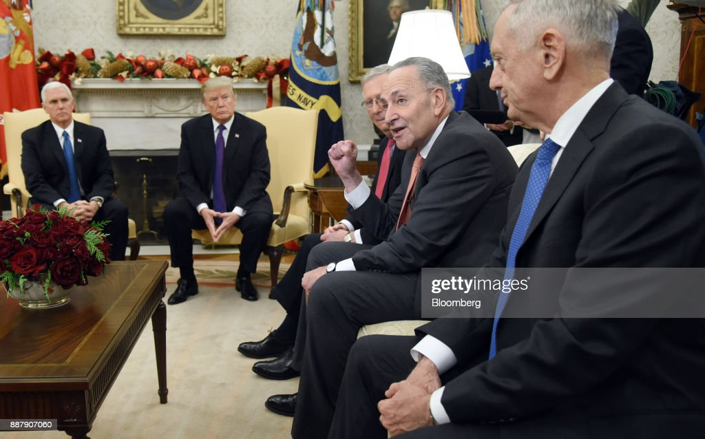 Senate Minority Leader Chuck Schumer, a Democrat from New York, center right, speaks as U.S. Vice President Mike Pence, from left, U.S. President Donald Trump, Senate Majority Leader Mitch McConnell, a Republican from Kentucky, and Jim Mattis, U.S. Secretary of Defense, listen during a meeting in the Oval Office of the White House in Washington, D.C., U.S., on Thursday, Dec. 7, 2017. Trump is meeting with the congressional leaders from both parties to negotiate on a long-term budget deal as Congress prepares to pass a stopgap spending measure to avoid a U.S. government shutdown Saturday. Photographer: Olivier Douliery/Pool via Bloomberg