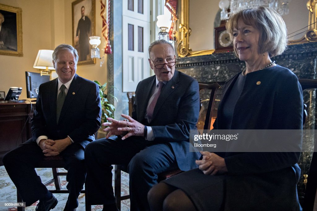 Senate Minority Leader Chuck Schumer, a Democrat from New York, center, speaks with Senator Doug Jones, a Democrat from Alabama, left, and Senator Tina Smith, a Democrat from Minnesota, during a meeting at the U.S. Capitol in Washington, D.C, U.S., on Wednesday, Jan. 3, 2018. Two new Democrats arrived in the U.S. Senate today, reducing the Republican majority to one vote and lifting the number of women in the chamber to a record level. Photographer: Andrew Harrer/Bloomberg via Getty Images