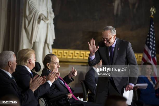 Senate Minority Leader Chuck Schumer a Democrat from New York center waves to US President Donald Trump second left after greeting former Senate...