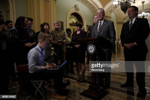 Senate Minority Leader Chuck Schumer a Democrat from New York center right speaks during a news conference after a Senate Democratic weekly luncheon...