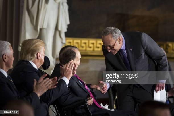Senate Minority Leader Chuck Schumer a Democrat from New York greets former Senate Majority Leader Bob Dole center left during a Congressional Gold...