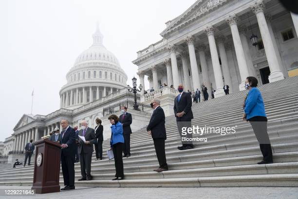 Senate Minority Leader Chuck Schumer a Democrat from New York left speaks at a news conference during a boycott of the Senate Judiciary Committee...