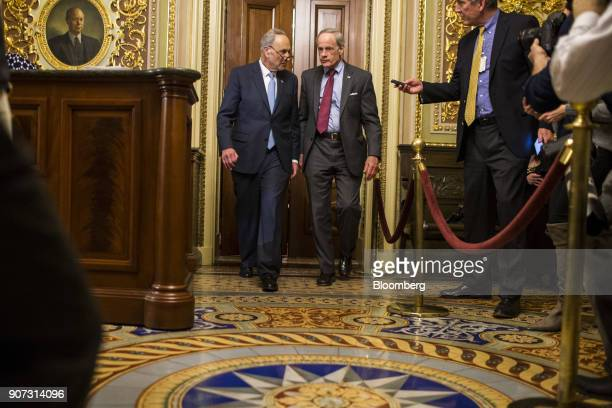 Senate Minority Leader Chuck Schumer a Democrat from New York left and Senator Tom Carper a Democrat from Delaware walk to the Senate Floor at the US...