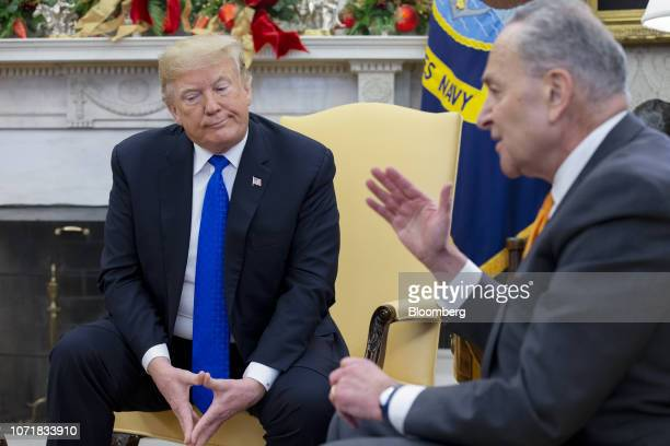 Senate Minority Leader Chuck Schumer a Democrat from New York right speaks while US President Donald Trump listens during a meeting at the Oval...