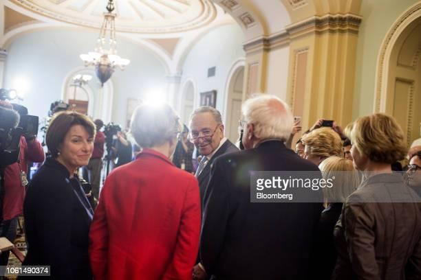 Senate Minority Leader Chuck Schumer a Democrat from New York speaks with Senator Amy Klobuchar a Democrat from Minnesota from left Senator Elizabeth...
