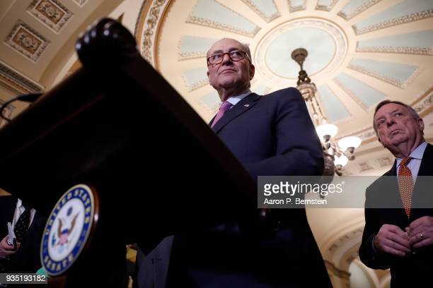 Senate Minority Leader Chuck Schumer accompanied by Sen Dick Durbin speaks with reporters following the weekly policy luncheons on Capitol Hill March...