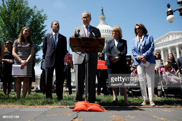 Senate Minority Leader Chuck Schumer accompanied by Sen Maggie Hassan House Minority Leader Nancy Pelosi and Rep Anthony Brown speaks with reporters...