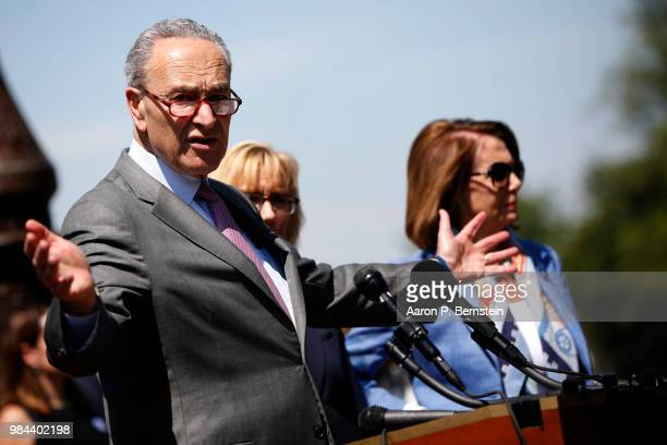 Senate Minority Leader Chuck Schumer alongside House Minority Leader Nancy Pelosi speaks with reporters outside the US Capitol June 26 2018 in...