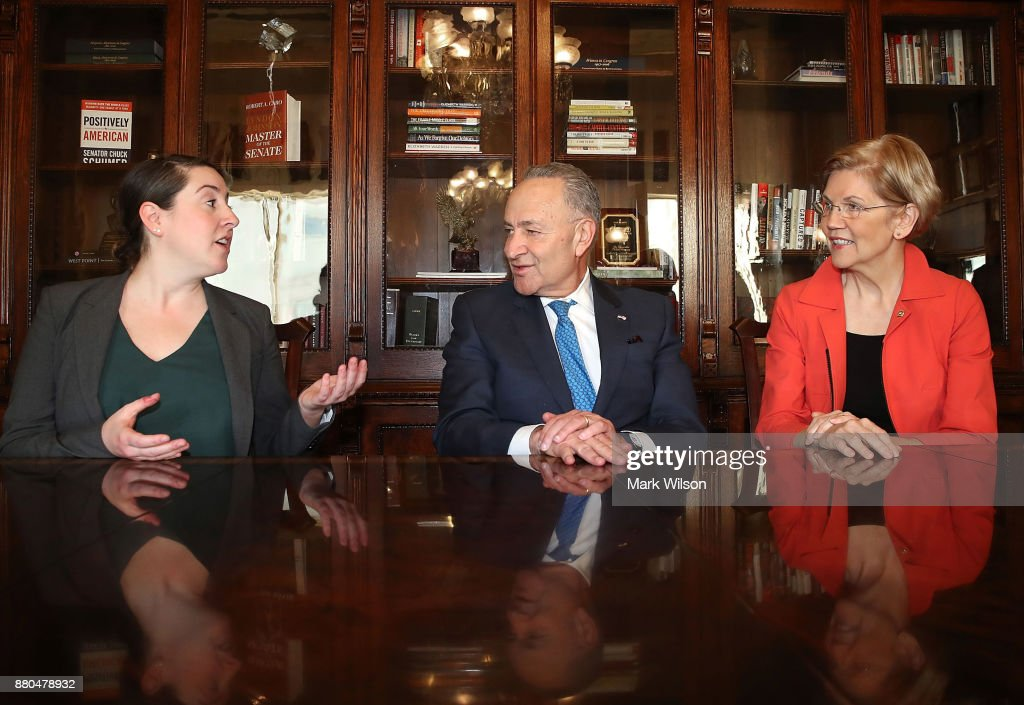 Senate Minority Leader Chuck Schumer (D-NY)(C) and Sen Elizabeth Warren (D-MA)(R), meet with Leandra English (L), current acting director of the CFPB at the US Capitol on November 27, 2017 in Washington, DC.
