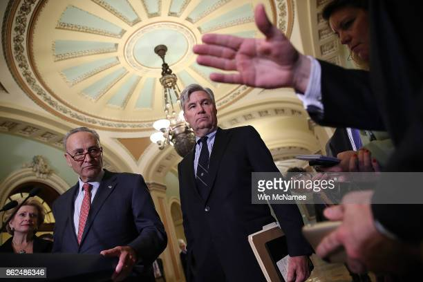 Senate Minority Leader Chuck Schumer and Sen Sheldon Whitehouse answer questions during a news conference following the weekly Democratic policy...