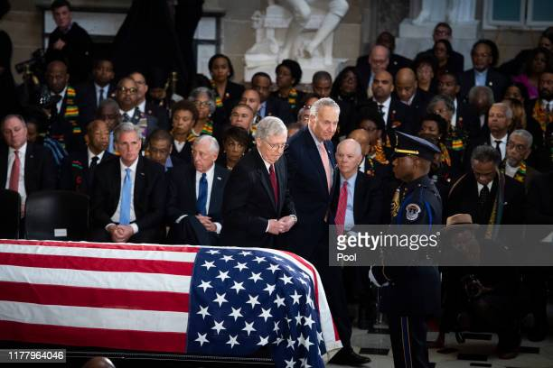 Senate Minority Leader Chuck Schumer and Senate Majority Leader Mitch McConnell rise to pay respects to the late Rep Elijah Cummings during his...