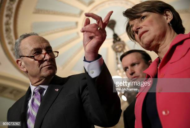 Senate Minority Leader Chuck Schumer answers questions during a press conference at the US Capitol February 27 2018 in Washington DC Schumer answered...