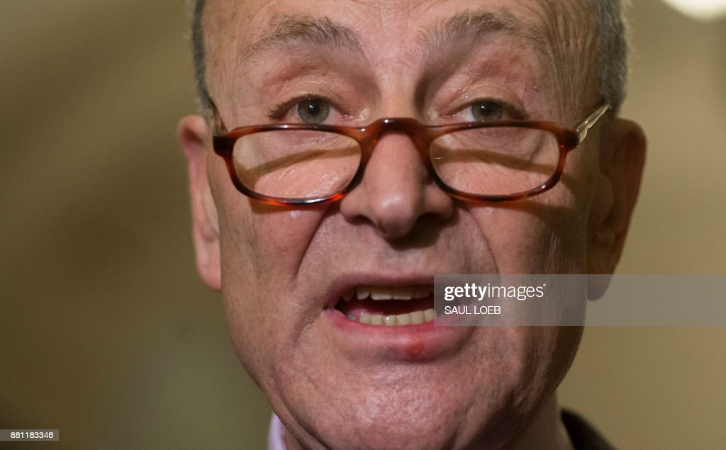 Senate Minority Leader Chuck Schumer, Democrat of New York, speaks to the media about his decision not to attend a meeting with US President Donald Trump, during a press conference at the US Capitol in Washington, DC, November 28, 2017. /
