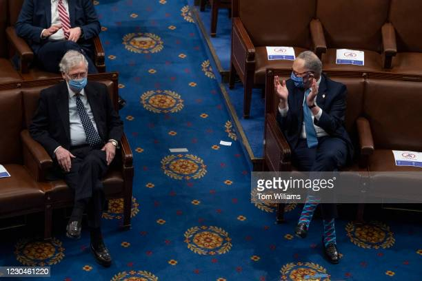Senate Minority Leader Chuck Schumer, D-N.Y., right, and Majority Leader Mitch McConnell, R-Ky., attend the joint session of Congress to certify the...
