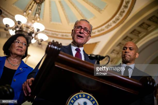 Senate Minority Leader Chuck Schumer gives remarks alongside fellow Senate Democrats Sen Mazie Hirono and Sen Cory Booker during a news conference...