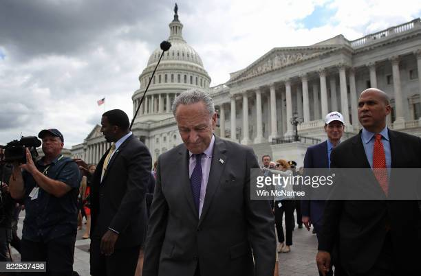 Senate Minority Leader Chuck Schumer leads Democratic members of the Senate to a press conference after Republicans successfully passed a key...