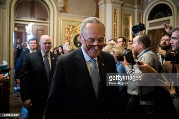 Senate Minority Leader Chuck Schumer leaves a meeting with Senate Democrats on Capitol Hill January 22 2018 in Washington DC Lawmakers are continuing...