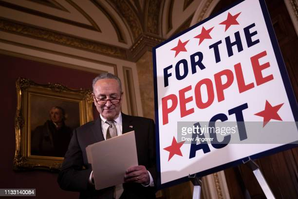 Senate Minority Leader Chuck Schumer looks over notes before speaking during a press conference to unveil the For The People Act at the U.S. Capitol,...