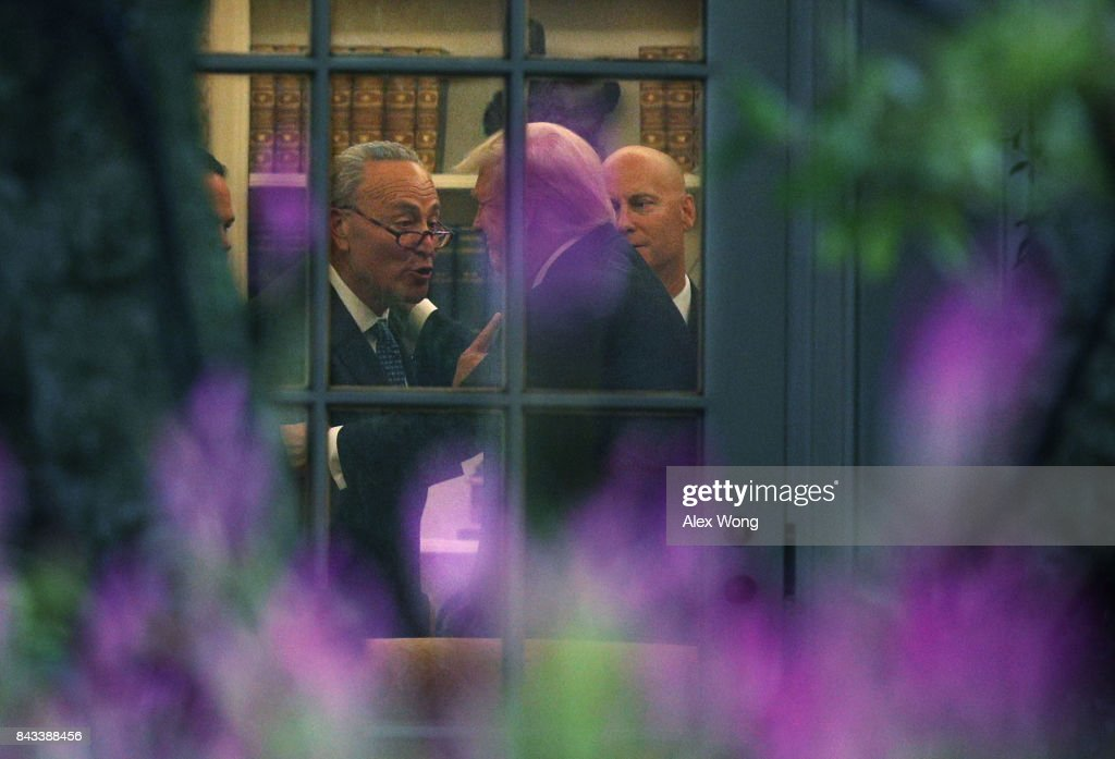 Senator Chuck Schumer and Trump discussing a point in the Oval Office, Washington, DC, September 6, 2017.
