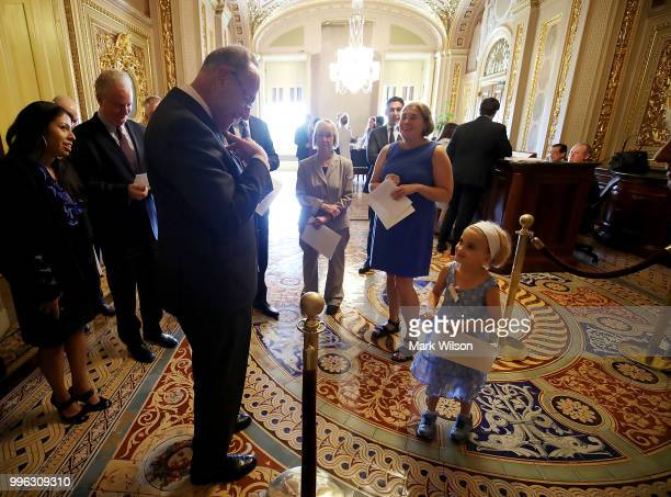 Senate Minority Leader Chuck Schumer (D-NY) meets 6 yo Charlie Wood who has complex medical needs from being born 3 months early, before a news conference about healthcare on Capitol Hill, on July 11, 2018 in Washington, DC. Schumer urged Senate Republicans not to dismantle our current health care system that would leave millions of American families without access to affordable health care.