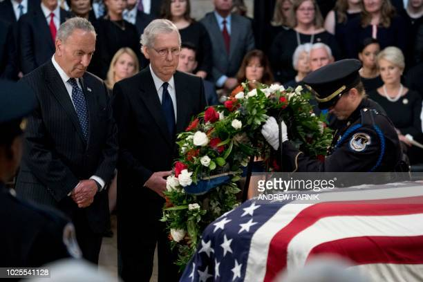 Senate Minority Leader Chuck Schumer of New York and Senate Majority Leader Mitch McConnell of Kentucky watch as a wreath is placed at the casket of...
