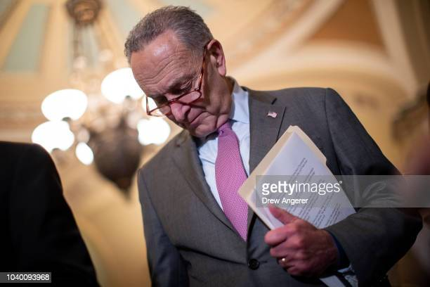 Senate Minority Leader Chuck Schumer pauses while speaking to reporters following the weekly Democratic policy luncheon on Capitol Hill September 25...