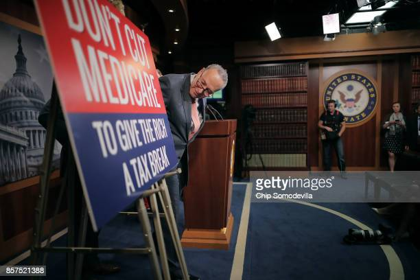 Senate Minority Leader Chuck Schumer prepares for a news conference with members of the House and Senate Budget and Finance committees critical of...