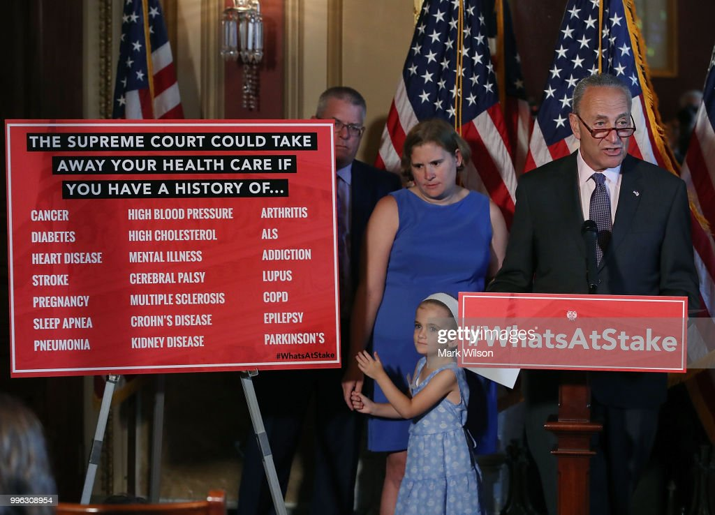 Senate Minority Leader Chuck Schumer (D-NY) speaks about healthcare while flanked by 6 yo Charlie Wood who has complex medical needs from being born 3 months early, during a news conference on Capitol Hill, on July 11, 2018 in Washington, DC. Schumer urged Senate Republicans not to dismantle our current health care system that would leave millions of American families without access to affordable health care.