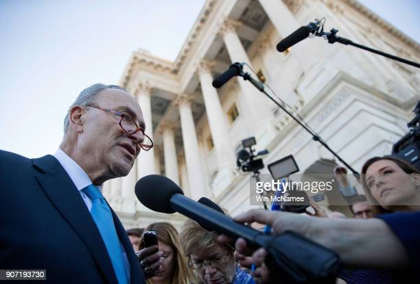 Senate Minority Leader Chuck Schumer speaks briefly with reporters after returning to the US Capitol after meeting with US President Donald Trump on...