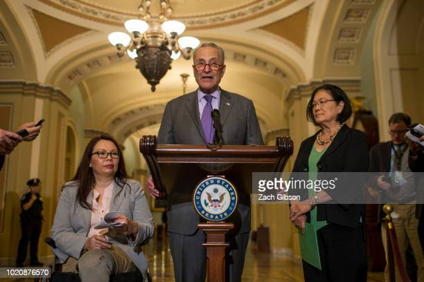Senate Minority Leader Chuck Schumer speaks during a weekly news conference on Capitol Hill on August 21 2018 in Washington DC Also pictured are Sen...