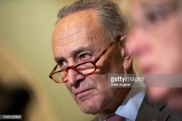 Senate Minority Leader Chuck Schumer speaks to reporters following the weekly Democratic policy luncheon on Capitol Hill September 25 2018 in...