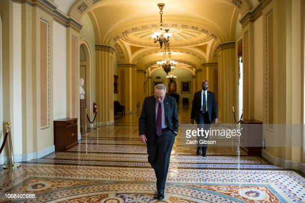 Senate Minority Leader Chuck Schumer walks to his office at the US Capitol Building on December 4 2018 in Washington DC Senate Democrats held a...