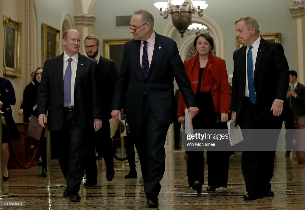 Senate Minority Leader Chuck Schumer (2nd L) (D-NY) walks with fellow Democratic senators to a press conference following the weekly policy luncheons at the U.S. Capitol on February 13, 2018 in Washington, DC. Schumer answered a range of questions focused primarily on the immigration reform efforts in the U.S. Senate. Also pictured (L-R) are Sen. Chris Coons (D-DE), Sen. Nancy Klobuchar (D-MN) and Sen. Richard Durbin (D-IL).