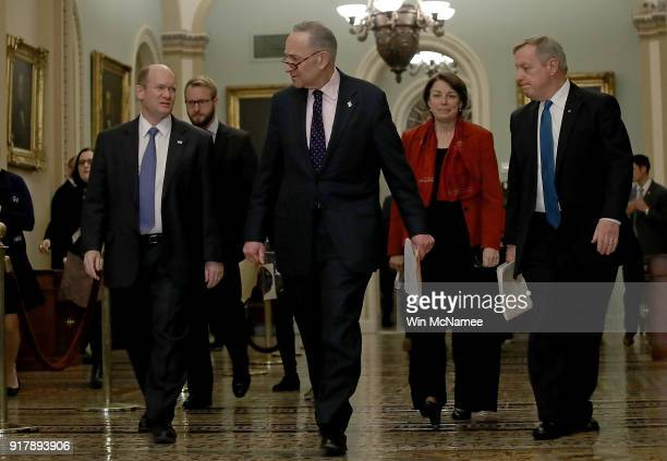 Senate Minority Leader Chuck Schumer walks with fellow Democratic senators to a press conference following the weekly policy luncheons at the US...