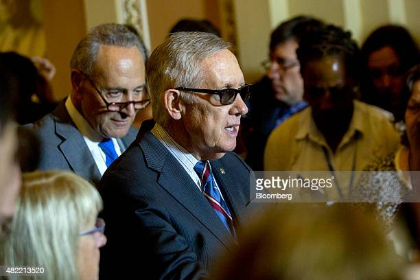 Senate Minority Leader Harry Reid a Democrat from Nevada center speaks during a news conference after a Democratic Senate luncheon with Senator...