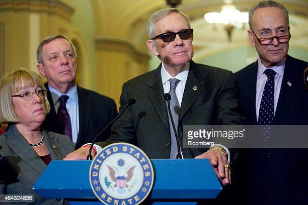 Senate Minority Leader Harry Reid a Democrat from Nevada center listens to a question during a news conference following a Senate luncheon at the US...