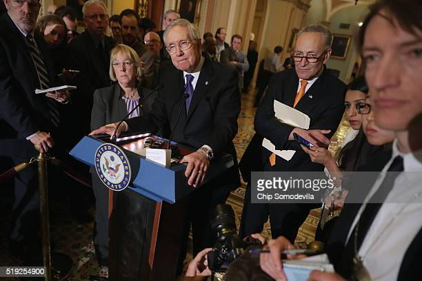 Senate Minority Leader Harry Reid and fellow Democratic senators LR0 Sen Patty Murray and Sen Charles Schumer talk to reporters following their...
