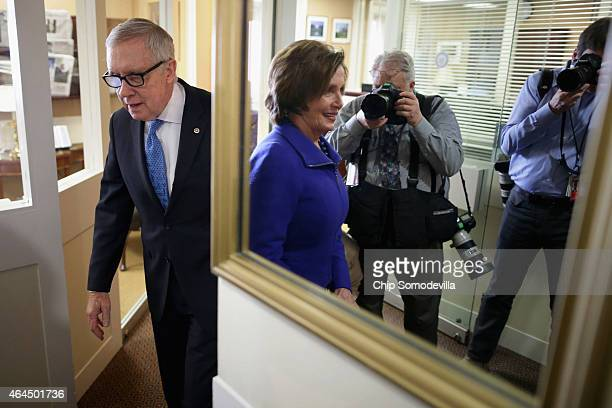 Senate Minority Leader Harry Reid and House Minority Leader Nancy Pelosi arrive for a news conference in the Radio Television Gallery at the US...