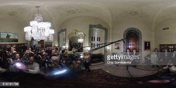 Senate Minority Leader Harry Reid and Judge Merrick Garland pose for television photographers in Reid's office at the US Capitol March 17 2016 in...