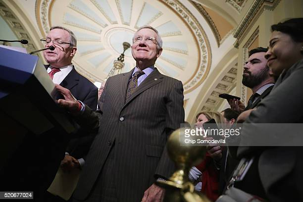 Senate Minority Leader Harry Reid and Senate Minority Whip Richard Durbin talk to reporters following the weekly Senate Democratic policy luncheon at...