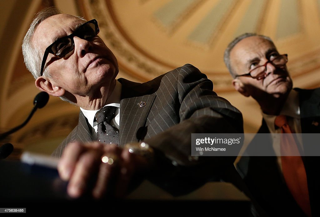 Senate Minority Leader Harry Reid answers questions as Sen. Chuck Schumer looks on at the U.S. Capitol June 2, 2015 in Washington, DC. Reid and Schumer spoke following the weekly Democratic caucus policy luncheon.